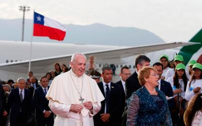 Pope Francis walks with Chilean President Michelle Bachelet as he arrives at the international airport in Santiago, Chile, Jan. 15. (CNS photo by Paul Haring)