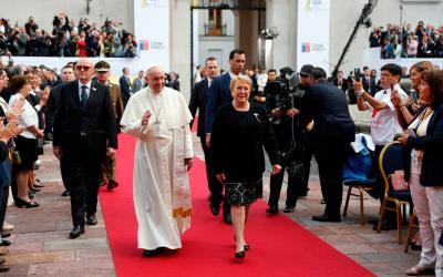 Pope Francis walks with Chilean President Michelle Bachelet after arriving for a meeting with government authorities, members of civil society and the diplomatic corps Jan. 16 at La Moneda presidential palace in Santiago. (CNS photo by Paul Haring)