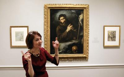 "Ginger Hammer, an assistant curator at the National Gallery of Art in Washington, gestures during a Feb. 20 media preview of the ""Heavenly Earth: Images of Saint Francis at La Verna"" exhibit at the gallery. (CNS photo by Bob Roller)"