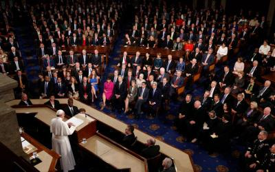 Pope Francis addresses a joint meeting of Congress at the U.S. Capitol in Washington in this Sept. 24, 2015, file photo. As the pope marks his fifth anniversary in the papacy, a new Pew Research poll of U.S. Catholics shows their regard of the pope is, for the first time, colored by their political leanings. (CNS photo by Paul Haring)