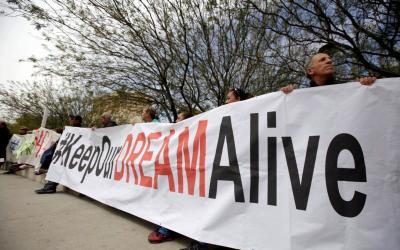 "03.06.2018  Members of the Border Network for Human Rights and Borders Dreamers and Youth Alliance hold a banner during protest March 5 outside a U.S. Federal Courthouse in El Paso, Texas, to demand that Congress pass a ""clean"" DREAM Act to save the Deferred Action for Childhood Arrivals. The measure is the Development, Relief and Education for Alien Minors Act. (CNS photo by Jose Luis Gonzalez/Reuters)"