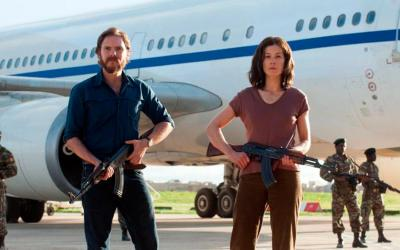 """Daniel Bruhl and Rosamund Pike star in a scene from the movie """"7 Days in Entebbe."""" The Catholic News Service classification is A-III -- adults. The Motion Picture Association of America rating is PG-13 -- parents strongly cautioned. Some material may be inappropriate for children under 13. (CNS photo by Focus Features)"""
