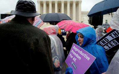 Pro-life advocates and a counter-demonstrator gather March 20 outside the U.S. Supreme Court in Washington as the court hears oral arguments in NIFLA v. Becerra, a case about freedom of speech at crisis pregnancy centers. (CNS photo by Jonathan Ernst/Reuters)
