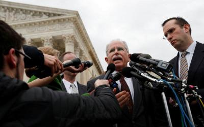 Mark Janus addresses the media outside of the U.S. Supreme Court in Washington Feb. 26. Janus, an Illinois state employee, sued over the union at his workplace making him pay fair-share fees as a nonunion member. He said it was unconstitutional and the high court in a ruling June 27 sided with him in the case, Janus v. AFSCME. (CNS photo by Leah Millis, Reuters)