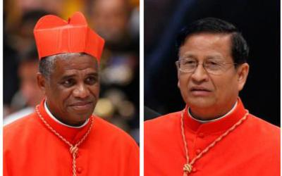 Pictured are two of the four cardinals who have been appointed by Pope Francis to preside over sessions of the October 2018 Synod of Bishops on young people, the faith and vocational discernment. From left are Cardinal Desire Tsarahazana of Toamasina, Madagascar and Cardinal Charles Bo of Yangon, Myanmar. (CNS photos/Paul Haring)
