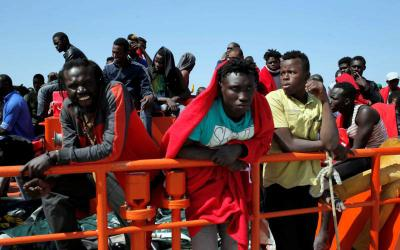 Migrants, intercepted aboard a makeshift boat in the Mediterranean Sea, are seen after arriving on a rescue boat July 22 at the Spanish port of Algeciras. (CNS photo by Jon Nazca/Reuters)