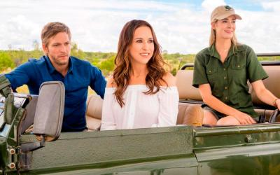 """Chicago Web designer Kira Slater, played by Lacey Chabert, center, appears with park rangers Tom, played by Jon Cor, and Ally, played by Brittany Bristow, in the heartwarming TV movie """"Love on Safari,"""" premiering July 28, 9-11 p.m. EDT on cable's Hallmark Channel. (CNS photo by Maritz Verwey/Crown Media)"""