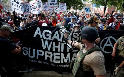White nationalists are met by counter-protesters in Charlottesville, Va., Aug. 12, 2017, during a rally over plans to remove the statue of a Confederate general from a city park. In advance of the Aug. 12 anniversary of the protests and counter-protests that led to violence and the death one person, Bishop Barry C. Knestout of Richmond asked people to pray for justice, peace and an end to racism on the first anniversary. (CNS photo by Joshua Roberts, Reuters)
