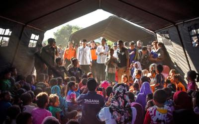 Indonesian President Joko Widodo, center, talks to earthquake victims inside a tent shelter July 30 on the island of Lombok in Indonesia. At least 16 people were killed and hundreds injured July 29 in the magnitude 6.4 earthquake. (CNS photo by Ahmad Subaidi, Antara Foto via Reuters)