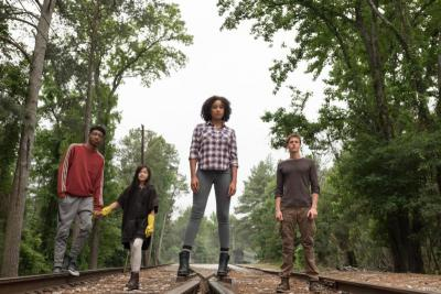 "Skylan Brooks, Miya Cech, Amandla Stenberg and Harris Dickinson star in a scene from the movie ""The Darkest Minds."" (CNS photo by Fox)"