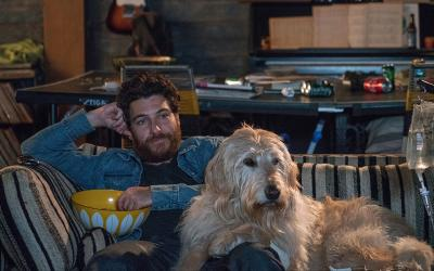"Adam Pally stars with a dog named Charlie in a scene from the movie ""Dog Days."" (CNS photo by LD Entertainment)"