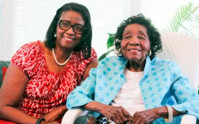 Vashti Jackson Woodson, right, sits with her daughter Veronica Ramseur July 26 at the home they share in Columbia, S.C. Woodson, who attends St. Martin de Porres Church with her family, will turn 100 Aug. 25. (CNS photo by Christina Lee Knauss/The Catholic Miscellany)