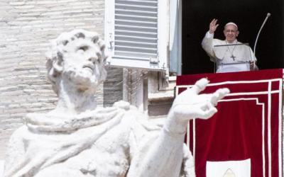 Pope Francis waves as he leads the Angelus from the window of his studio overlooking St. Peter's Square at the Vatican Aug. 15, the feast of the Assumption. (CNS photo by Claudio Peri/EPA)