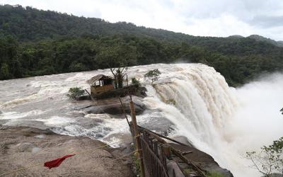 A makeshift shelter is seen Aug. 13 on the edge of Athirapally Falls in India's Kerala state. The Catholic Church has joined relief efforts as unprecedented floods and landslides continue to wreak havoc in Kerala, killing at least 75 people within a week. (CNS photo by Prakash Elamakkara/EPA)
