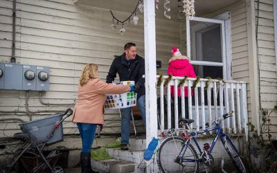 <p>Sue (from left), Dan and Molly O'Connell deliver a Christmas basket to a home in Elmira Dec. 16. The Christmas-basket project was a joint effort of all of Elmira's Catholic parishes. (Photos by Rick Bacmanski)</p>