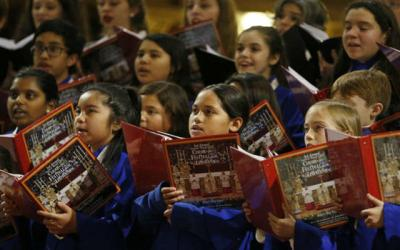<p> Choir members from U.S. parishes sing in an Epiphany Festival concert at the Church of St. Ignatius in Rome Jan. 3. Choirs from the parishes of St. Matthew and Mother Teresa of Calcutta in Topeka, Kan., and the children's choir from the Diocese of Orange, Calif., performed at the concert. </p>