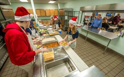 <p>Elmira Notre Dame High School students serve dinner at Elmira Community Kitchen Dec. 6. (Photo by Rick Bacmanski) </p>
