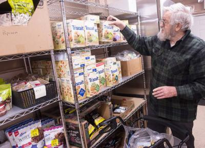 <p>Chuck Kent stocks items at Life Solutions of Hamlin's food pantry Jan. 10. (Courier photo by John Haeger)  </p>