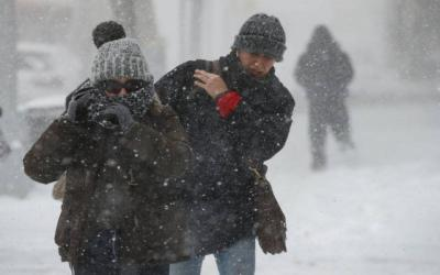<p>People struggle against wind and snow as they cross a street Jan. 4 in the Brooklyn borough of New York City.  </p>