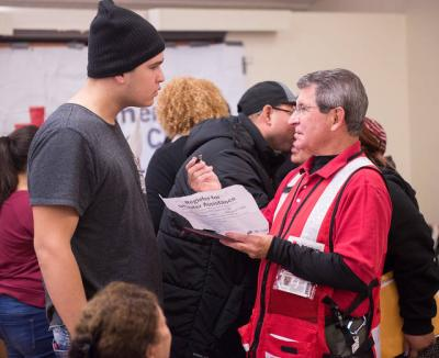 <p>Red Cross volunteer Alvani Santos answers questions about paperwork Nov. 9 for Puerto Ricans who came to Rochester in the wake of the devastation caused by Hurricane Maria.  </p>