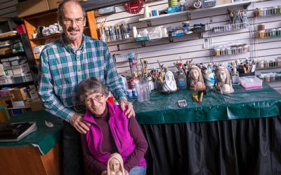 "<p>David and Mary Hoysic pose at their Phelps studio Dec. 13 with artwork created by the late Maryknoll Sister Marie Pierre Semler. Mary Hoysic is holding a sculpture titled ""God With Us.""  </p>"