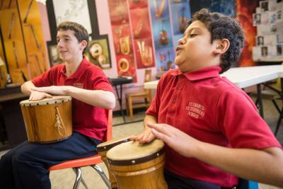 <p>Fifth-grader Evan Espinosa (right) and his St. Francis-St. Stephen School classmates take part in a drum circle at the Geneva school Jan. 24. (Courier photo by John Haeger)  </p>