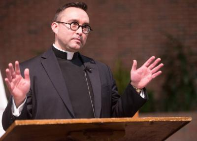 <p>Father Matt Jones gives a presentation on the Eucharist Jan. 23 at St. Lawrence Church in Greece. (Courier photo by John Haeger) </p>