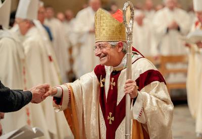 <p>Salvatore R. Matano greets well-wishers as he processes out of his installation Mass at Rochester's Sacred Heart Cathedral. (File photo) </p>