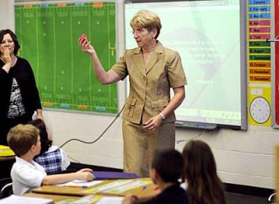 Kathleen Carroll retired as principal of St. Louis School in Pittsford. Above, she talks to students on the first day of the 2009-10 school year.