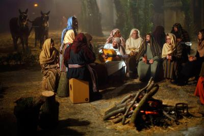 People dressed as villagers from ancient Bethlehem sing Christmas carols as they take part in a re-enactment of the Nativity in the town of Arcos de la Frontera, Spain, Dec. 20.