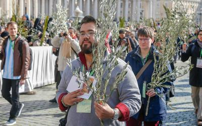 <p>Nick Lopez, a youth delegate from the United States participating in the Vatican's pre-synod meeting, walks in procession at the start of Palm Sunday Mass celebrated by Pope Francis in St. Peter's Square at the Vatican March 25.  </p>