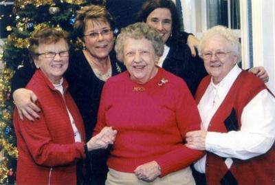 Dorothy Miller (center) poses with friends during a Dec. 29, 2009, party she threw to thank her many friends and supporters