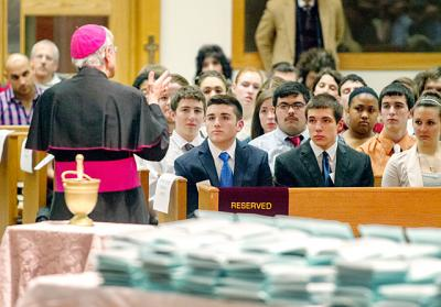 High school seniors listen to a homily from Bishop Salvatore R. Matano before receiving their Hands of Christ awards at St. Pius Tenth Church in Chili Feb. 25.