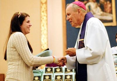 "Aryn Smith, a parishioner of Hornell's Our Lady of the Valley Parish, receives her Hands of Christ award from Bishop Matthew H. Clark March 28 at Greece's Our Mother of Sorrows Church. (<a href=""http://catholiccourier.smugmug.com/Other/2011-Hands-of-Christ-in-Greece/16503088_zpNYR#1242195379_43n8R"" target=""_blank"">Click  here</a> to view more photos from this event and/or buy prints.)"