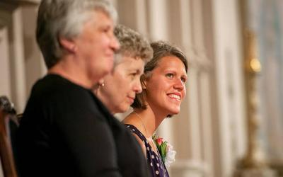 <p>Sister Anita Kurowski (right) smiles as she sits with Sister Mary Lou Mitchell (center) and Sister Anne Alderman during the profession of her finals vows as a Sister of St. Joseph of Rochester Aug. 30, 2014. (File photo) </p>