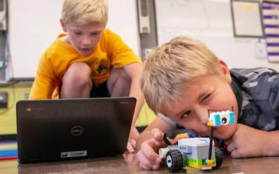 <p>Fifth-grader Ronan Turkavich (left) and second-grader Owen Schubert work on programming their Lego robot during a robotics class at Canandaigua's St. Mary School June 20. (Courier photo by Jeff Witherow)  </p>