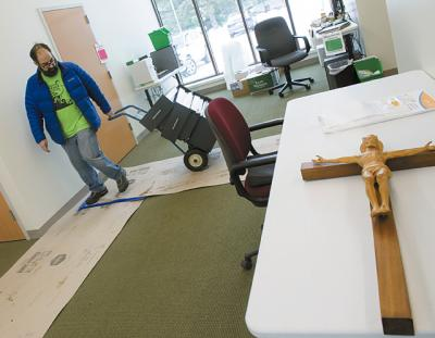 Tom King works to move offices items into the  new parish center at  St. Catherine of Siena on Monday, Feb. 13, 2017 in Ithaca.