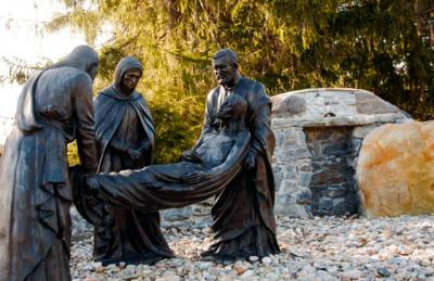 A life-size depiction of Jesus being laid in the tomb is seen April 9 in the Stations of the Cross on the grounds of the National Shrine of the Divine Mercy in Stockbridge, Mass.