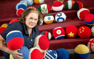 <p>Gina Mangiamele's vision of praying for peace around the world turned into The Giant Mary Queen of Peace International Rosary Project, a 55-foot-long, five-decade rosary featuring beads crocheted to depict the flags of different countries.(Courier photo by Jeff Witherow)  </p>