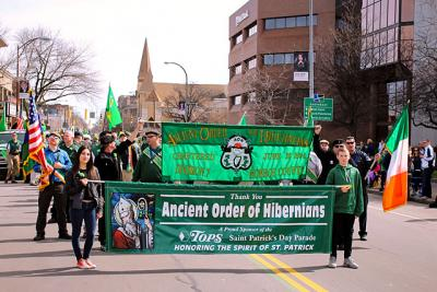 Members of the Ancient Order of Hibernians march down Rochester's East Avenue in the St. Patrick's Day parade March 12, 2016.