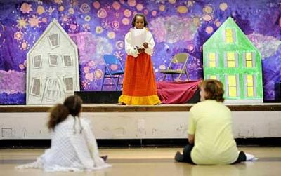 "Eight-year-old Arianna Colbert reads lines from the play ""Oliver Twist"" during Light of Christ Parish's theater camp at the former St. Andrew School in Rochester July 29. (<a href=""http://catholiccourier.smugmug.com/Events/2010-Light-of-Christ-Theatre/13393370_ochtK#974357013_mTfb4"" target=""_blank"">Click  here</a> to view more photos from this event and/or buy prints.)"