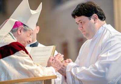 Deacon Jorge Ramírez (right) pledges obedience to Bishop Salvatore R. Matano during the June 2015 deacon ordination Mass.