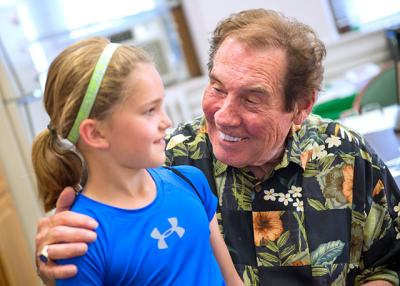 On June 21, Catherine Staley says goodbye to St. Agnes School Principal Dr. Gerald Benjamin.
