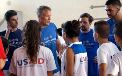 Philadelphia 76ers Coach Brett Brown gives pointers to Arab and Israeli youth during a July 30 basketball clinic sponsored by PeacePlayers International in Jerusalem. Brown and Villanova University Coach Jay Wright participated in a weeklong program that teaches tolerance and instills tools for peacemaking through basketball.
