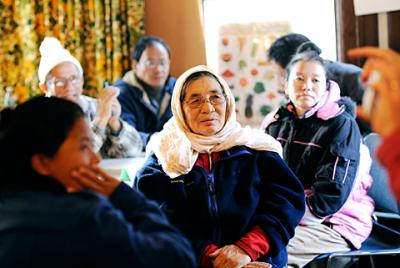 Refugees from Nepal listen carefully during an English lesson Dec. 6 at Mary's Place, a refugee outreach center in Rochester that also offers food, clothing, tutoring and counseling services.