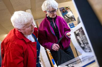 Jeannine Clark (left), Class of 1941, and Therese LeGro, Class of 1950, look over a yearbook during an alumni weekend at St. Michael School in Penn Yan Nov. 5.