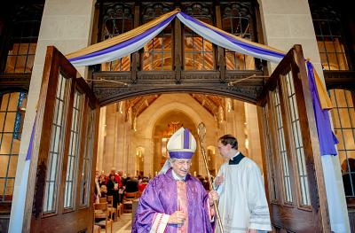 Bishop Matano walks through the Holy Door at the conclusion of the Mass to mark the start of the Jubilee Year of Mercy Dec. 13, 2015.