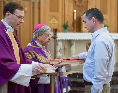 Dermot Loughran, who will be ordained to the permanent diaconate May 27, made his profession of faith and oath of fidelity to Bishop SalvatoreR. Matano during daily Mass April 10 at the diocesan Pastoral Center in Gates.