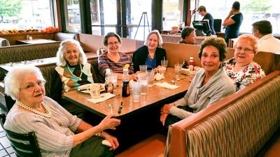 Sacred Heart Cathedral parishioner Theresa Mingoia (at head of the table), who turns 100 on Oct. 20, enjoys breakfast with her friends at the Peppermill Restaurant in Rochester Oct. 16.