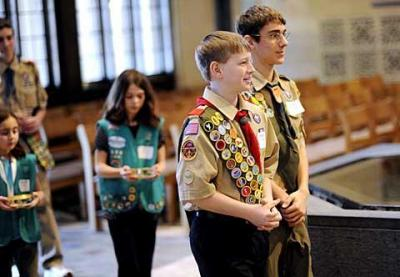 Boy Scouts Nathan Wolfe (front), a parishioner of Greece's St. Mark Church, and Austin Whitney, a parishioner of Greece's Holy Name of Jesus Church, take part in the Catholic Scouting recognition Mass at Sacred Heart Cathedral March 6.